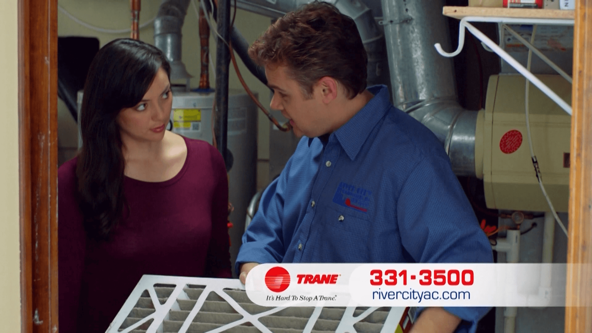 A woman discussing with a technician from River City Heating & Cooling | Emergency HVAC Services