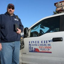 An employee of River City Heating & Cooling | Heating and Cooling
