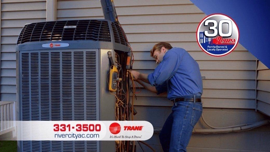 A man servicing an HVAC system | HVAC Unit