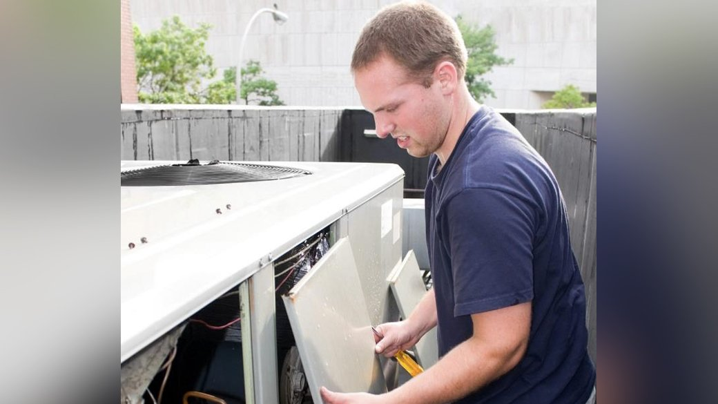 A man fixing an HVAC system | HVAC Company